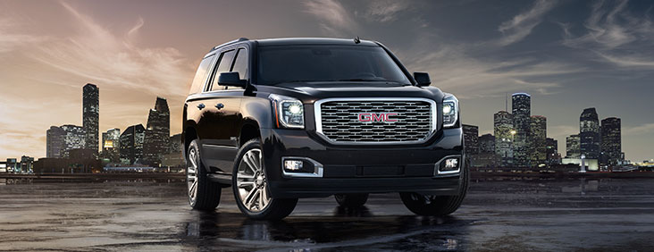 2017 Yukon Denali full size luxury SUV with polished chrome wheels and grill.