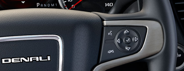 Steering wheel controls of the 2015 Yukon Denali full size luxury SUV.
